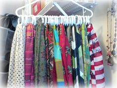 Organized scarves: one hanger, two packs of dollar store shower curtain rings, and ten minutes. Done!