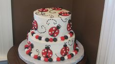 This is a 6 and 8 inch cake covered in buttercream with lady bug accents. I cut the lady bugs out with round pieces of fondant.