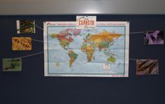 """Postcard display idea from Diane Staudt: """"Last year I put up maps of the US and world. When I'd get a postcard, I would pin it to my wall, and link it to its place of origin with a string. People loved coming to see the wonderful postcards! And I loved looking at them, too! So, I'm doing that again this year."""""""