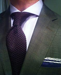 British spread collar and knit tie