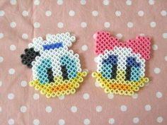 donald and daisy / Hama perler beads / Bügelperlen Hama Beads Design, Hama Beads Patterns, Beading Patterns, Pearler Beads, Fuse Beads, Hama Beads Disney, Pixel Beads, Iron Beads, Melting Beads