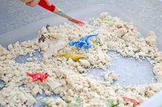 Create a fun dinosaur archaeology activity using cloud dough. Two simple ingredients plus dinosaurs will make a sensory activity for toddlers & prechoolers.