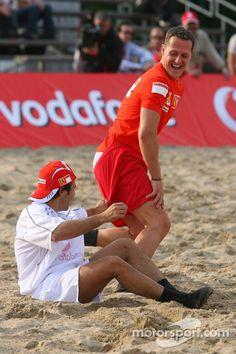Vodafone Ferrari Beach Soccer Challenge: as Michael Schumacher stands up Felipe Massa pulls down Michael's shorts at Spanish GP