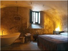 Sextantio Albergo Diffuso: Rustic-chic Executive Suites mix old and new, with antique stone floors and modern bath tubs.