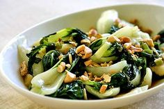 Quick and easy baby bok choy recipe.  Baby bok choy sauteed in olive oil with garlic, green onions and a dash of sesame oil.  Then mixed with roasted, salted cashews.