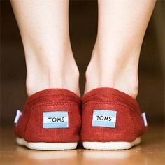 How to get the smell out of Toms shoes:  Baking Soda  Place shoes within a pillow case, tie the end and put in washing machine.  After adding normal detergent, measure a 1/2 cup of baking soda and run the wash cycle on cold. air dry in direct sunlight