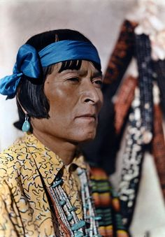 New Mexico - A portrait of a Native American wearing turquoise earrings, Santa Fe.  1920-30's