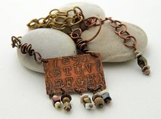 Etched alphabet on copper with a steampunk by DragonflyDreamers, $42.00