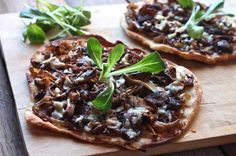 Tapenade and Mushroom Flatbreads  Saute your favorite mushroom vareity with sliced Cipolline Balsamico onions. Place the flat bread on a cookie sheet. Spread black tapende onto flat bread add the sauted mushroom mixture. Crumble goat cheese over top of the flat bread.  Place the flat bread  under the broiler unit cheese is melted. Easy and delish.
