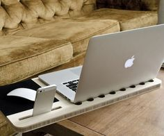 Slate Mobile AirDesk / The Slate Mobile AirDesk is one of those perfect laptop accessories that you likely never knew you needed. The problem is that a laptop takes away some of the comforts of the desk. http://thegadgetflow.com/portfolio/slate-mobile-airdesk/