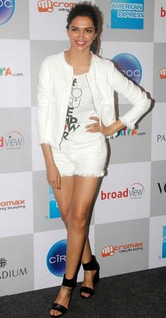 Which is not to say that Deepika wasn't looking stylish, as she does.The actress was on trend in white hot pants and jacket by T by Alexander Wang, teamed with a T-shirt emblazoned with the event's theme - 'Empower.' We like the hot pink lips.
