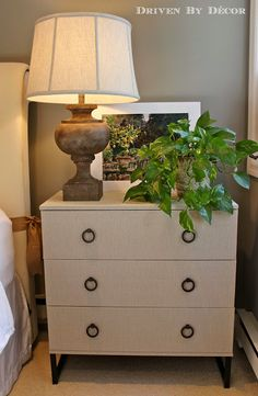 An inexpensive IKEA chest transformed into a high-end looking fabric-covered beauty using a Target tablecloth!