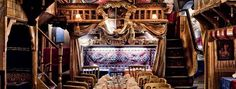 Does a set menu for £33 for 3 courses. Sarastro  An opera-themed, Mediterranean / Turkish restaurant on Drury Lane that offers actual operatic performances by both professional singers and staff alike