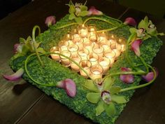 Square floral wreath with votives would be perfect on an entrance table.