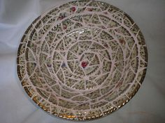 https://flic.kr/p/77RFpT | Mosaic plate | I used bits of two old chipped plates with silver edging here and mounted them on another larger old plate/bowl.