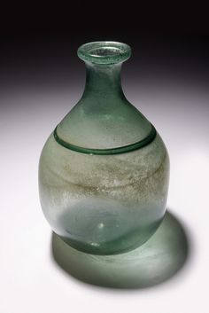 Mouth-blown glass bottle from  Saft el-Hinna, Egypt.  3289 by The Manchester Museum, via Flickr