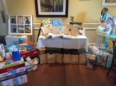 Gift table with baby shower bag game