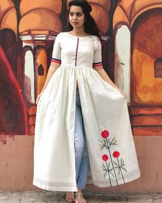 This white chanderi cape looks just as elegant as the embroidered flowers on it's side panel. The flowers embroidered in resham threads contrast the colour white and make the overall outfit a perfect beauty to add up to your wardrobe. Indian Gowns Dresses, Indian Fashion Dresses, Dress Indian Style, Indian Designer Outfits, Designer Dresses, Designer Kurtis, Simple Kurti Designs, Kurta Designs Women, Frock Fashion