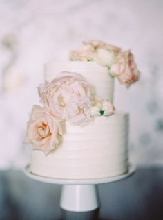 Decorated with peonies and roses: http://www.stylemepretty.com/collection/2640/
