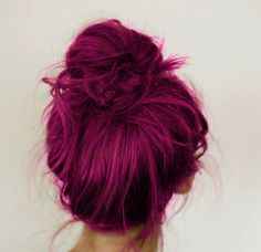 Bright magenta hair. You could achieve a colour like this using Indola 7.67 professional dye, or Fudge Headpaint 7.5.