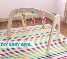 Great gift idea!  Ana White | Build a Wood Baby Gym | Free and Easy DIY Project and Furniture Plans