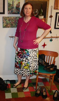 Top untucked. Old navy multicolored skirt with ballet flats and pink long sleeve top - several cardigans to match. (I didn't feel like taking stockings or tights on and off, so imagine them on my pale legs.)