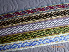 https://flic.kr/p/bKSepa | More inkle bands Apr 2012 | Bands woven in handspun wools, all about 50 inches by about 1.5 inches.