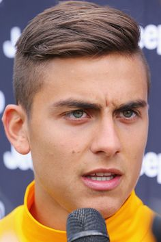 Paulo Dybala of Juventus speaks to media during a Richmond Tigers AFL and Juventus FC media opportunity at Punt Road Oval on July 20, 2016 in Melbourne, Australia.