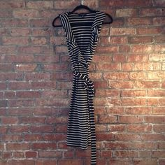 Black and white strip wrap dress A perfect classic addition to your closet!  Black and white stripe wrap dress. Ties at waist and Ruffles on front. Super flattering on all body types.  Rayon fabric moves nicely and is light weight. Banana Republic Dresses