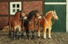 Customized Breyer Stablemate drafter-Allereirau. Someone buy me some more horses; I've got some customizing to do, too!