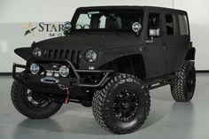 Custom 2014 Jeep Wrangler Unlimited with Matte Black Kevlar Liner: Front-Left View