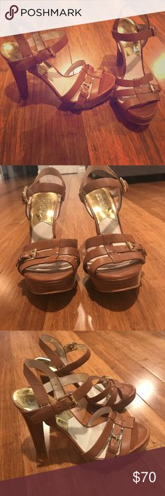 Michael Kors Platform Sandals Michael Kors Strappy Platform Sandals - Cognac Leather. Only used once. In excellent condition. Only marks are on sole of shoe otherwise perfect. Gold 5.5 inch heel. Size 7.5 Michael Kors Shoes Sandals