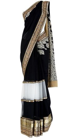 Obsessed with this black saree. I love the white sheer block towards the bottom