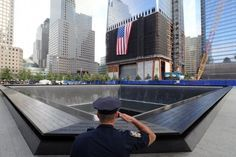 NEW YORK, NY - SEPTEMBER 11: New York City Police Officer Danny Shea, a military vet, salutes at the North pool of the 9/11 Memorial during the tenth anniversary ceremonies of the September 11, 2001 terrorist attacks at the World Trade Center site, September 11, 2011 in New York City. Photo By Pool/Getty Images