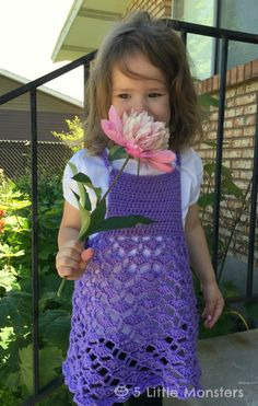 Crochet top for toddler girls. Straps button at the shoulder, the skirt is made with a lacy shell stitch.