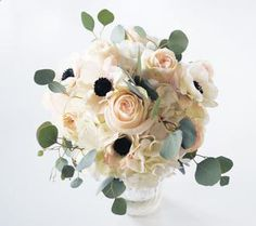 anemones and blush garden roses with eucalyptus