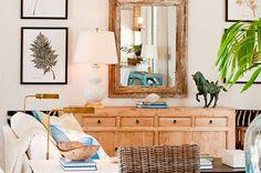 coastal style living room vignette leaf prints