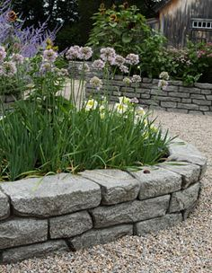natural looking faux stone wall raised flowerbeds