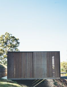 This Australian Abode Is a Glass Pavilion Wrapped in Sliding Hardwood Screens - Photo 11 of 11 - The home is cantilevered out over the hillside site.