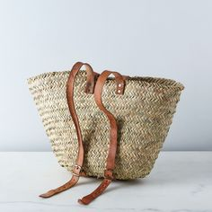 Add leather handles and straps to make it a basket backpack
