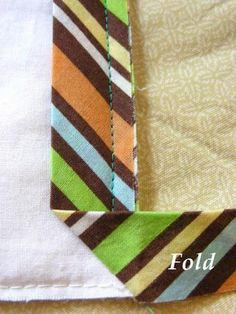 Tutorial on binding quilts with mitered corners, plus great tutorial on making bias tape and attaching the two ends of the sewed-on tape
