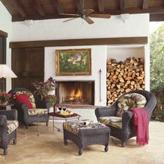 Big open fire and somewhere to stack the wood that's also decorative...love it