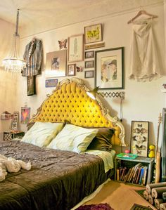 cool bohemian bedroom love the plush headboard and the collage of different pictures on the