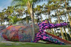 Installation of an alligator in a playground, amazing.
