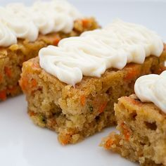 carrot zucchini bars with lemon cream cheese frosting 2 eggs 3/4 cup packed brown sugar 1/2 cup canola oil 1/4 cup honey 1 teaspoon vanilla 1 1/2 cups shredded carrots 1 cup shredded zucchini 1/2 cup chopped walnuts (optional) 1 1/2 cups all-purpose flour 1 teaspoon baking powder 1/2 teaspoon ground ginger 1/4 teaspoon baking soda Read more at: http://www.food.com/recipe/carrot-zucchini-bars-with-lemon-cream-cheese-frosting-462597?oc=linkback