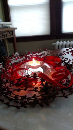Simple Center Piece: Red ribbon, pips and pinecones