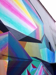 Bad@*& geometric wall murals: austin-based artist josef kristoletti just finished protein lite - his latest piece in panama city - rendering colorful three-dimensional looking prisms. the mural was painted for the first biennial of the south in panama 2013,