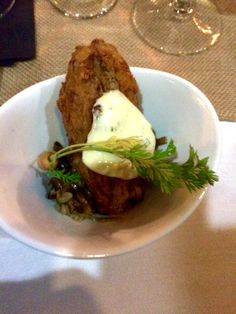 Braised beef tongue, rye crumb crusted, stuffed cabbage, Swiss, thousand island topping.