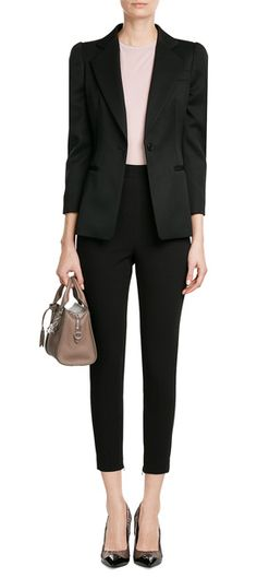 A tapered choice that will flatter most figures, this pair of black pants form Alexander McQueen are made from wool and cotton for a super luxurious feel and fit #Stylebop