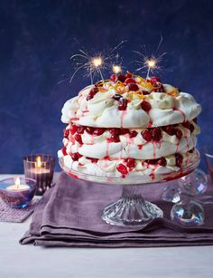 Cranberry orange meringue cake, from Sainsbury's magazine ... This cake has a real summertime vibe whilst the styling (and particularly those sparklers) suggest the evening ... making me think about warm summer nights, this would be the perfect light but sumptuous bake after a day of BBQ-ing!
